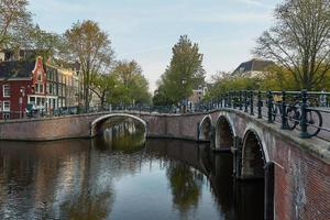 One of the many bridges over a canal in Amsterdam Netherlands photo