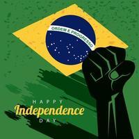 feliz día de la independencia de brasil con bandera y puño de mano vector