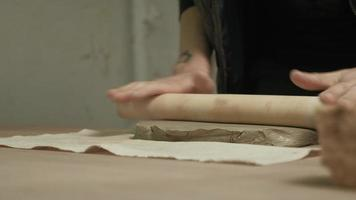 Ceramist Work in The Workshop with A Wooden Roller video