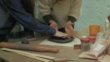 Ceramist work in the workshop video