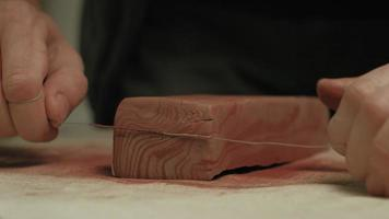 Ceramist Cutting Clay with Wire video