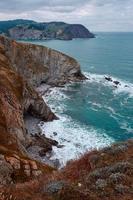 cliff rocks and sea in the coast in Bilbao spain photo