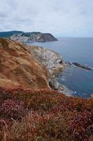 cliff  and rocks and seas in the coast photo