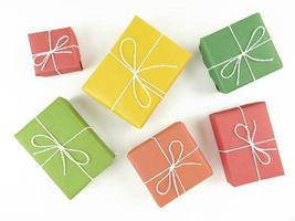 Red yellow green and orange gift boxes on a white background photo