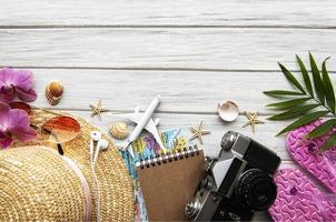 Traveler accessories on wooden  background photo