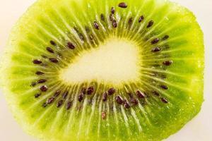 Background of kiwi fruit cut in half photo