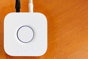 Smart Home Hub for home automation on wooden desktop with copyspace photo