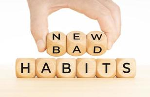 From Bad to new habits concept Hand turns a wooden blocks with bad to new words photo