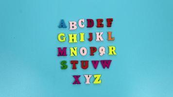 alfabetos, letra, aislado, fondo azul foto