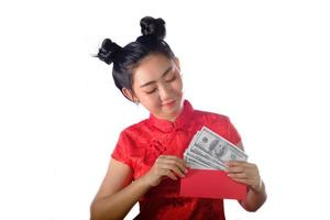 Portrait Asian woman red dress traditional cheongsam holding money 100 Us dollar bills at the white background photo