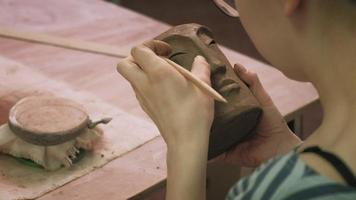 Working on A Clay Pottery Face video