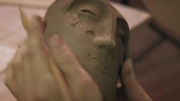 Close up Of Working on A Clay Pottery Face video