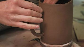 Sculpting a Brown Clay Mug video