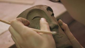 Close up of a Face Being Sculpted on a Mug video