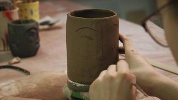 Sculpting a Face on A Mug video