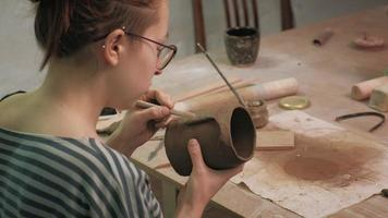 Sculptor Working on a Face on a Mug video