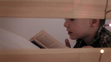 Child lies in bed insomnia poor sleep video