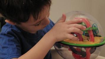 preschooler boy plays with puzzle game video