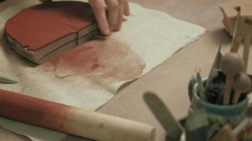 Ceramist Cutting Into a Block of Clay video