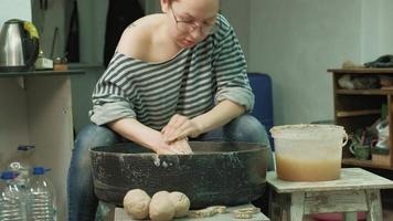 Woman Starts Making a Pottery Cup video