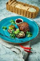 Steak with barbecue vegetables and loganberry sauce photo