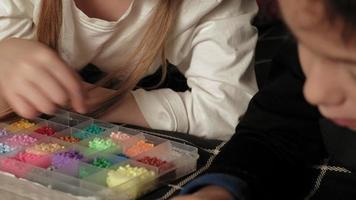 Children play with peeler beads fine motor development video