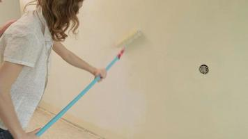 Women Painting an Apartment Wall video