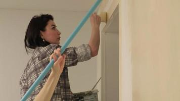 Two Women Painting Walls in an Apartment video
