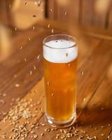 Beer mug glass with flying malted barley photo