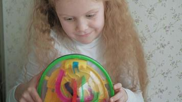 Little girl play with three dimensional toy puzzle video