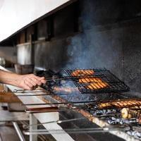 Frying fish meal kebab in smoke photo