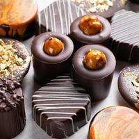 Tasty chocolate pieces close up photo