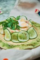 Children's salad with crab and cucumber slices photo