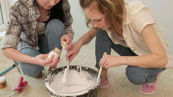 Two People Mixing White Paint video