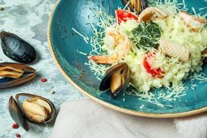 White rice with shrimps and mussels. photo
