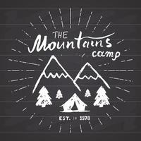 Mountains handdrawn sketch emblem. outdoor camping and hiking activity, Extreme sports, outdoor adventure symbol, vector illustration on chalkboard background