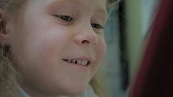 Girl preschooler uses a computer tablet video