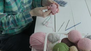 A young woman crochets video