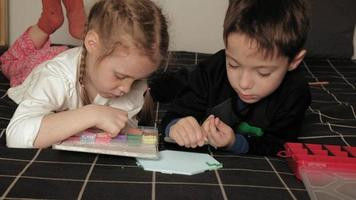 Children playing with peeler beads for fine motor development video