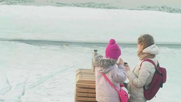 Family picnic on a frozen river video