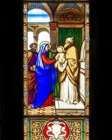 Stained glass at Como Cathedral in Italy photo
