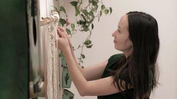 Woman weaves macrame on a stick video