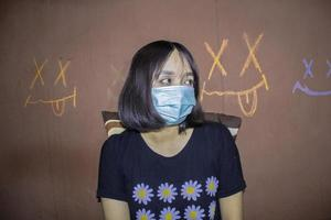 People Stylish Indie Short Hair Girl Wearing Blue Surgical Mask Protecting Herself From Corona Virus Covid19 Flat Vector photo