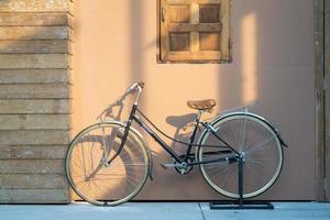 Vintage bike on wood house photo
