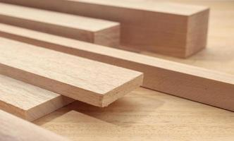 Group of assorted wood material like planks squares sheets Timber for carpentry photo