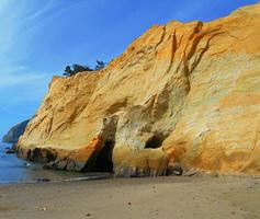 Golden Sea Stone a sandstone rock formation at Cape Kiwanda State Park Pacific City OR photo