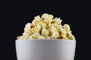 close up of mushroom Popcorn in a white bowl with black background photo