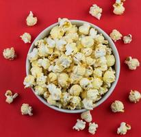 close up of mushroom Popcorn in a white bowl with red background photo