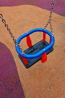 old swing in the playground photo