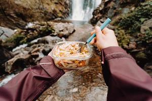 A point of view shot of a female hiker eating photo